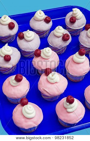 Party Muffins With Pink Icing, Whipped Cream And Cherry
