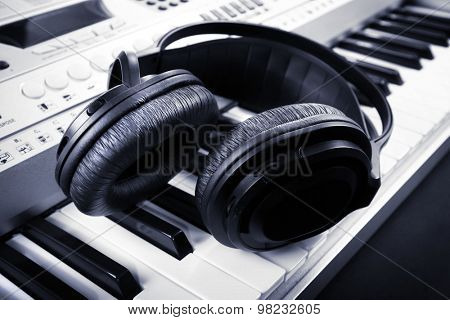 Headphones on synthesizer close up