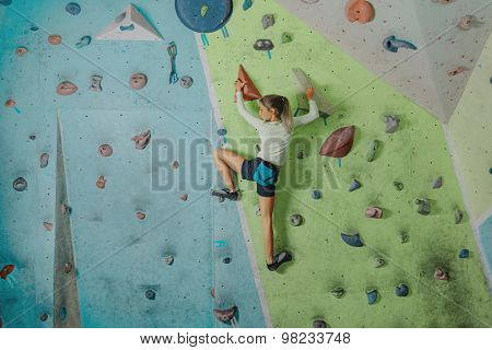 Little Girl Climbing In Gym