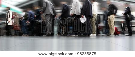 People Waiting In Line, Travellers In Queue