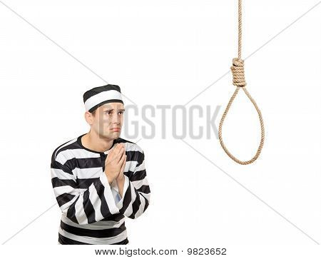 Sad Prisoner In Begging Gesture With A Noose