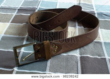 Leather Belt On Checkered Background