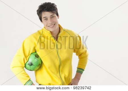 Young Man With A Football Ball.