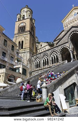 Tourists On The Steps In Front Of Amalfi Cathedral In Italy