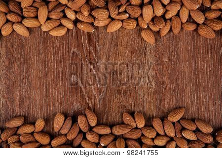 Grain Almonds On A Wooden Background