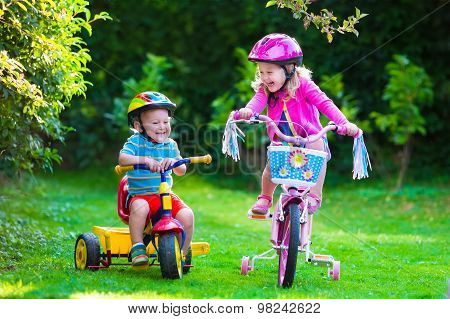 Two Children Riding Bikes