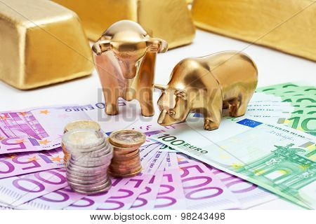 Golden Bear, Bull Figurines With Euro Coins  Gold Bars On Fanned Euro Notes