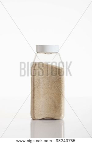 Garlic Granule Powder In Clear Container On White Background