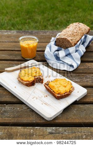 Picnic With Self-baked Wholemeal-wheat-spelt-bread And Carrot Spread