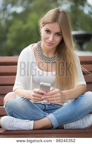 smart professional woman reading using phone. Female businesswoman reading news or texting sms on sm