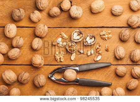 Walnuts And Nutcracker On Wood