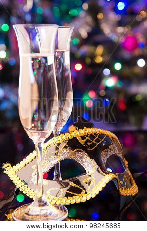 Two Champagne Glasses And A Mask