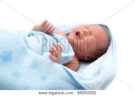 One week old crying baby in blanket on white background