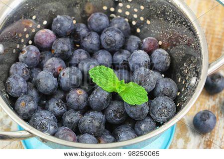 Blueberries in colander, closeup
