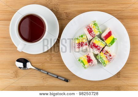Multicolor Turkish Delight In Glass Plate And Cup Of Tea