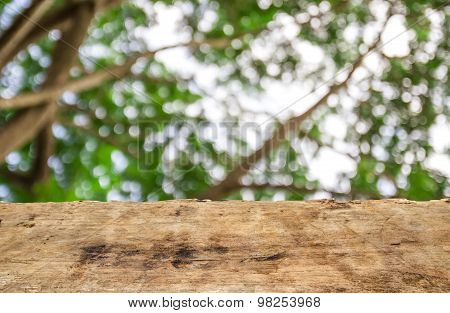 Old Wooden Table With Blurred Bokeh Background