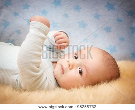 Baby on lamb wool