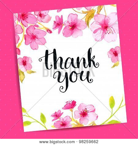 Thank you card with modern calligraphy and sakura flowers on pink background.
