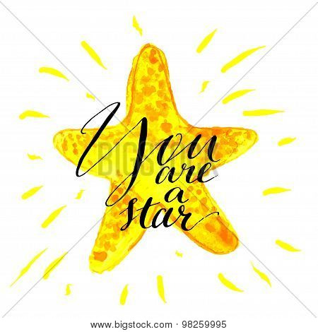 Modern calligraphy inspirational quote - you are a star- at yellow shiny watercolor background.