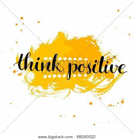 Modern calligraphy inspirational quote - think positive - at yellow watercolor background.