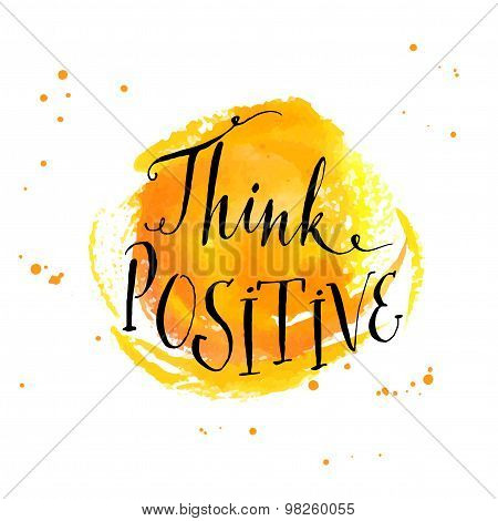 Modern calligraphy inspirational quote - think positive - at yellow watercolor