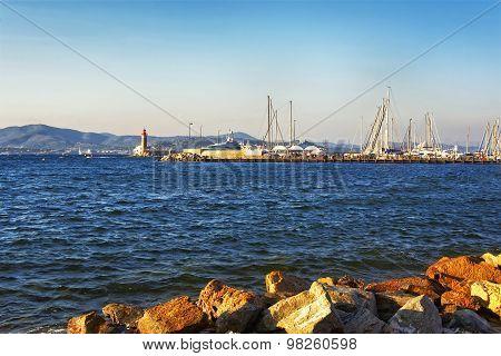 Saint Tropez Harbor Marina And Lighthouse In Sunset Light