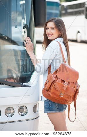 Attractive young girl is traveling by public transport