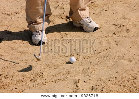 Jogador de golfe em um Sandtrap