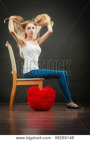 Sad Melancholy Woman With Red Heart Pillow