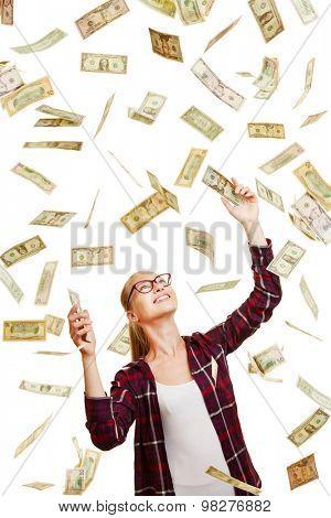 Happy lucky woman catching raining dollar money bills