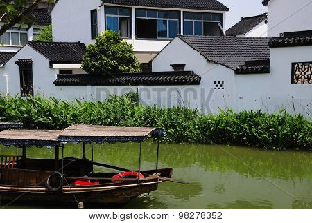 Empty Boat on Water Canals of Luzhi