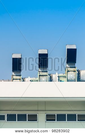 Industrial air conditioning and ventilation systems on a roof.