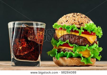 Hamburger, Cola With Ice On A Black Background