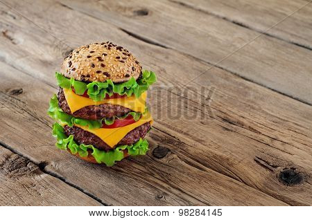 Burger On Wooden Background Closeup