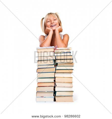 Back to school. Happy Smiling Schoolgirl sitting on stack of books isolated on a white background. Education concept, knowledge. Pretty school girl portrait