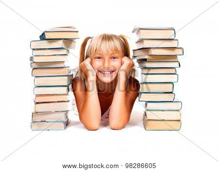 Back to school. Happy Smiling Schoolgirl lying between stacks of books isolated on a white background. Education concept, knowledge. Pretty school girl portrait