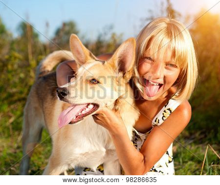 Child with Dog outdoors. Girl with her dog walking together, Friendship concept