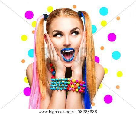 Beauty Funny Girl Portrait with Colorful Makeup, Hair and Accessories. Colourful Studio Shot of Surprised Woman. Vivid Colors, blue lipstick