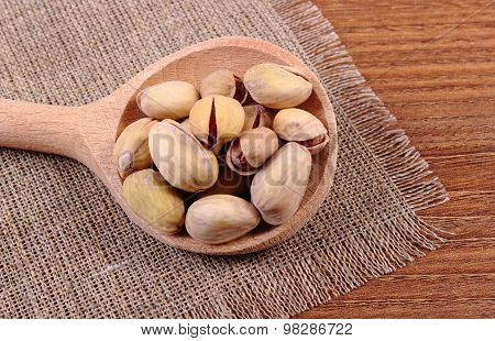 Pistachio Nuts With Spoon On Wooden Table, Healthy Eating