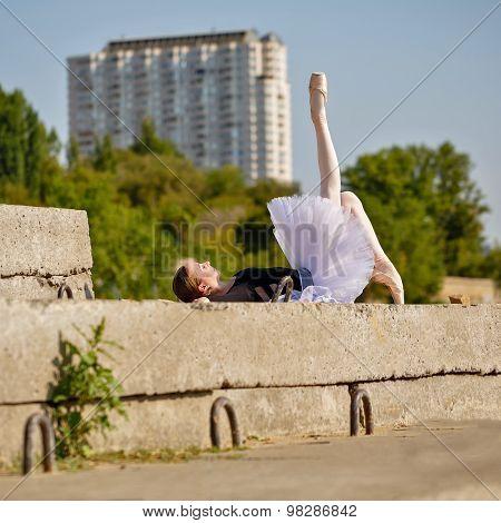 Slim Ballerina In Tutu Lying On The Street.