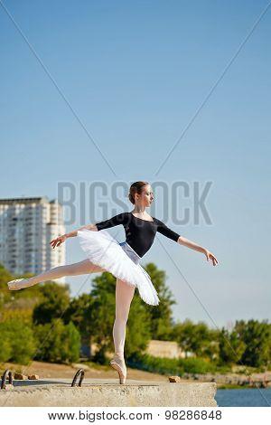 Ballet Dancer In Tutu Dancing On The Promenade. Arabesque