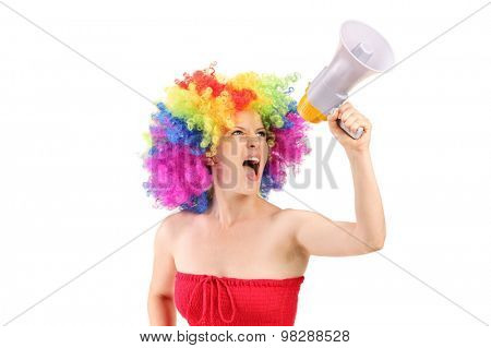 Woman with wig shouting on a megaphone isolated on white background
