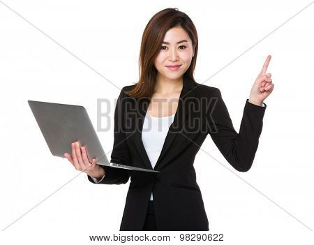 Asian Businesswoman use of the notebook computer and finger point up
