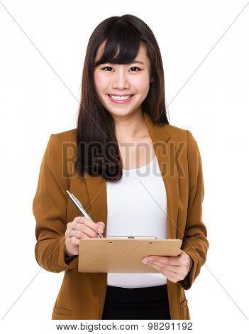 Asian businesswoman take note on clipboard