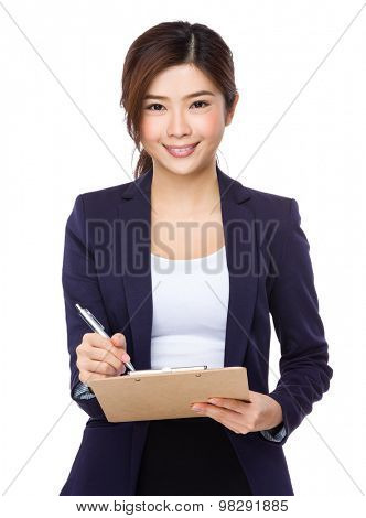 Asian Young businesswoman take note on clipboad