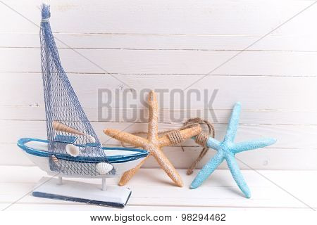 Decorative Sailing Ship And Marine Items On Wooden Background.
