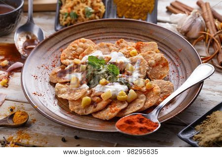 Indian Streetfood Papri Chaat Garnished And Served With Yoghurt