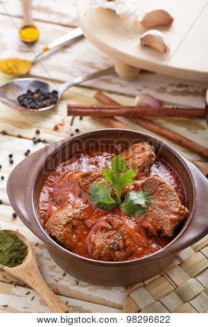 Indian Lamb Rogan Josh Served On Pot With Seasoning