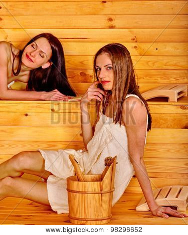 Young two happy beautiful woman in sauna.