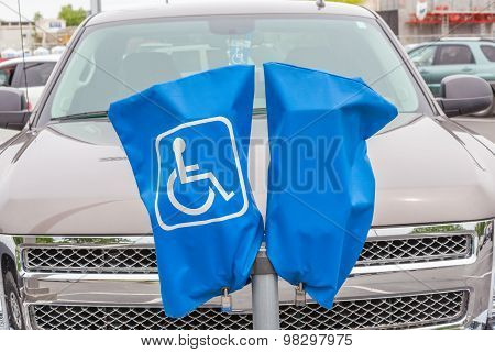Reserved Disabled Parking Sign On Blue Cover And Stand.